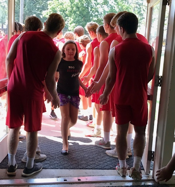 The PHS football team greeted the 4th graders with high fives as they came over to celebrate the team getting the play of the week by KAIT with ice cream!