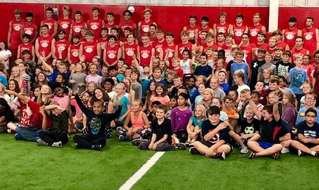 Group picture of the PHS football team and the M.D. Williams 4th graders after enjoying their ice cream!