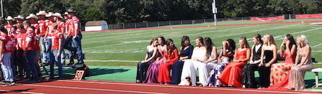 The Homecoming Court, Queen and football players at the pep rally.