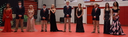The Homecoming Court awaiting the announcement of Queen.